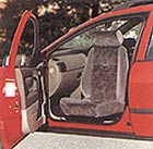 Picture of a swivel seat installed in a car.